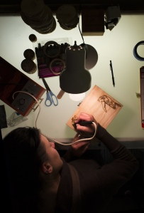 "After putting on calming music, Julie Macala sits down to start her wood burning for the night.  Though she has a daytime job, Julie sells her designs online and at festivals. ""It's very different.  It's kind of soothing and relaxing and smells really good when you're working,"" says Macala."