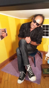 Ron posing in the little house the was used for Tiny Out Loud interviews