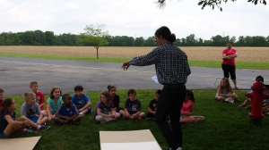 Gabe teaching cynanotype with nature paper to Brown Elementary School students