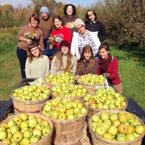 Jen with Pattycake employees on a field trip to get apples 2014